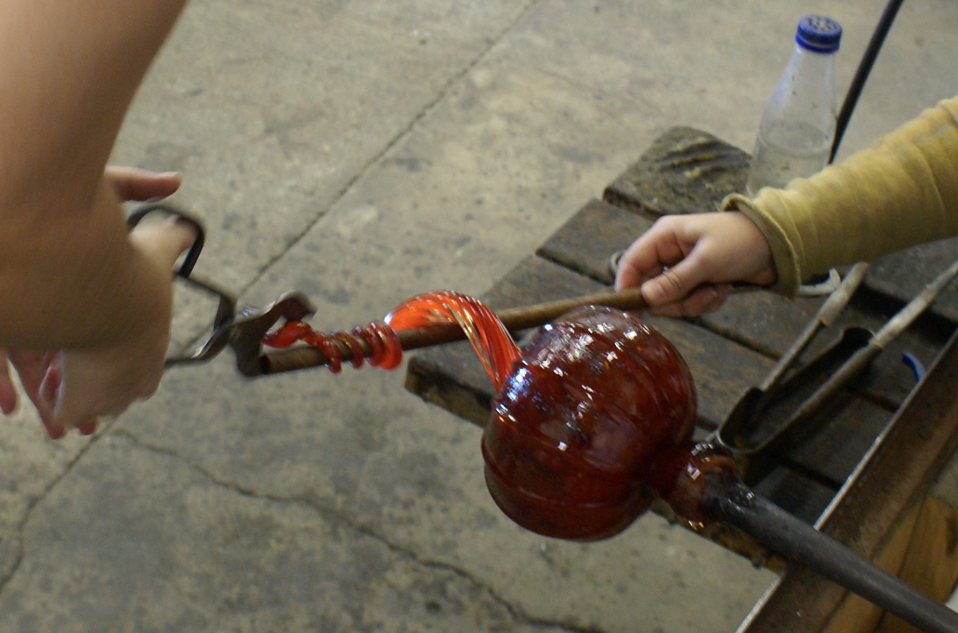 Wrap the hot glass stem around a pipe